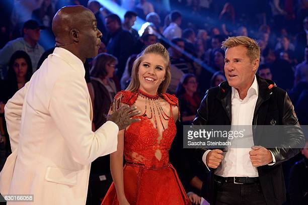 Bruce Darnell Victoria Swarovski and Dieter Bohlen react during the finals of the tv show 'Das Supertalent' at MMC studios on December 17 2016 in...