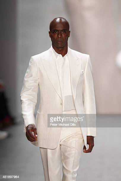 Bruce Darnell walks the runway at the Minx by Eva Lutz show during the MercedesBenz Fashion Week Spring/Summer 2015 at Erika Hess Eisstadion on July...