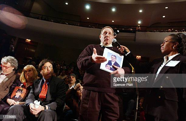 Bruce Decell holds a picture of his soninlaw Mark Petrocelli who was killed in the September 11 attacks on the World Trade Center at a public meeting...