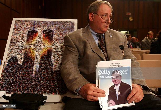 Bruce DeCell of Staten Island NY holds a picture of his soninlaw Mark Petrocelli who was killed in the World Trade Center during the second public...