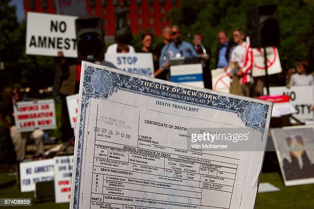 Bruce Decell whose soninlaw Mark Petrocelli died in the attacks of September 11th holds Petrocelli's death certificate during a rally against...