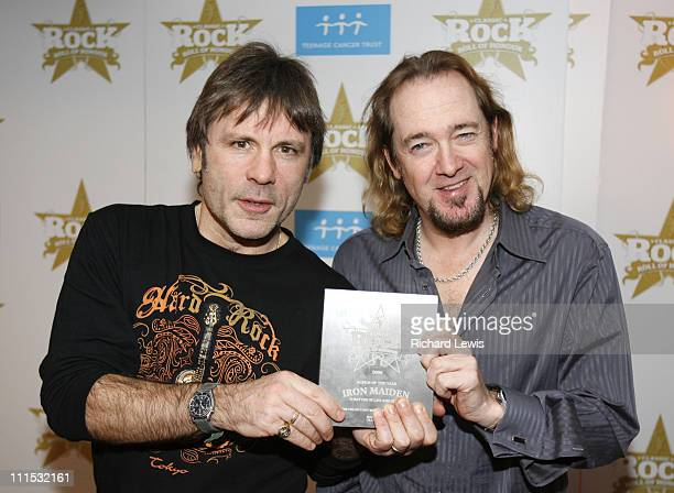 Bruce Dickinson and Adrian Smith of Iron Maiden during Classic Rock Roll Of Honour Press Room at Langham Hotel in London Great Britain