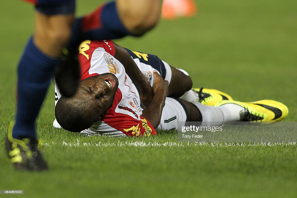 Bruce Djite of Adelaide lies injured during the round 27 A-League match between the Newcastle Jets and Adelaide United at Hunter Stadium on April 11, 2014 in Newcastle, Australia.