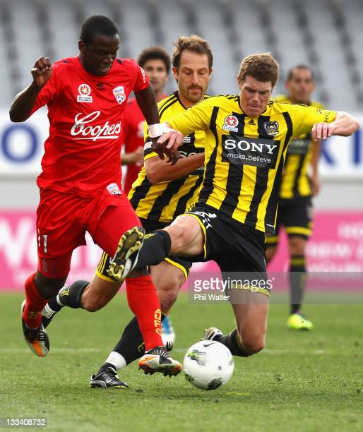 Bruce Djite of Adelaide United and Tony Lochhead of the Wellington Phoenix compete for the ball during the round seven A-League match between the...
