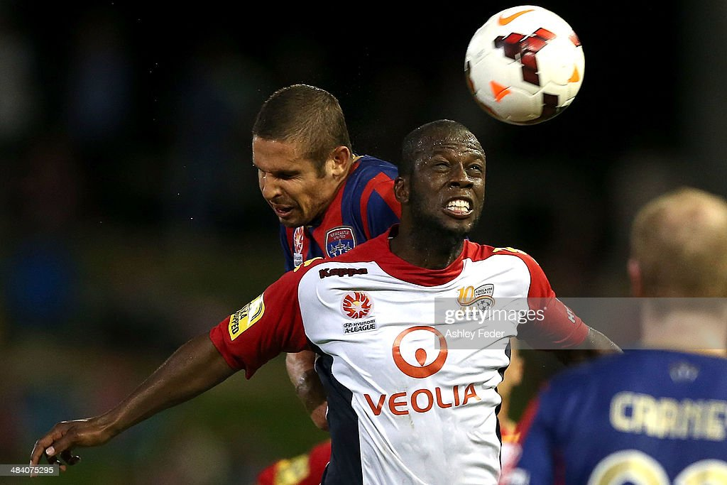 Bruce Djite of Adelaide United heads the ball during the round 27 A-League match between the Newcastle Jets and Adelaide United at Hunter Stadium on April 11, 2014 in Newcastle, Australia.