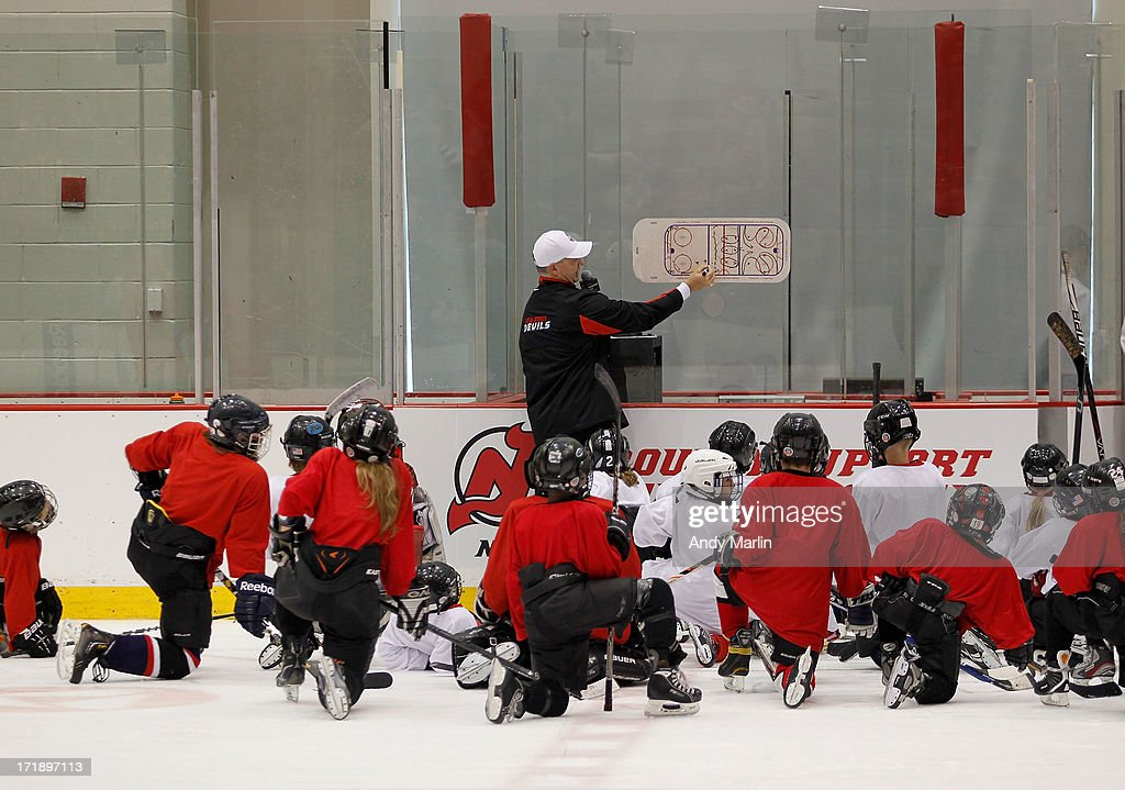 Bruce Driver diagrams a drill on the board for young participants during the 2013 NHL Draft - Top Prospects Clinic at Prudential Center on June 29, 2013 in Newark, New Jersey.