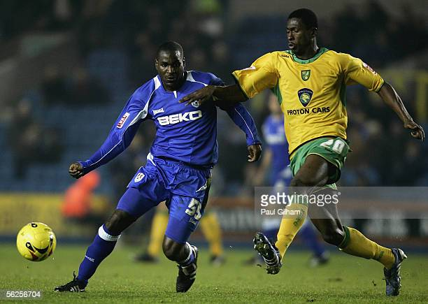 Bruce Dyer of Millwall battles for the ball with Dickson Etuhu of Norwich City during the CocaCola Championship match between Millwall and Norwich...