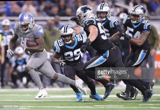 Bruce Ellington of the Detroit Lions runs away from the defense of the Carolina Panthers during the second half of the game at Ford Field on November...