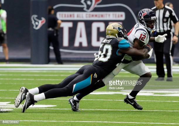Bruce Ellington of the Houston Texans is tackled by Telvin Smith of the Jacksonville Jaguars at NRG Stadium on September 10 2017 in Houston Texas