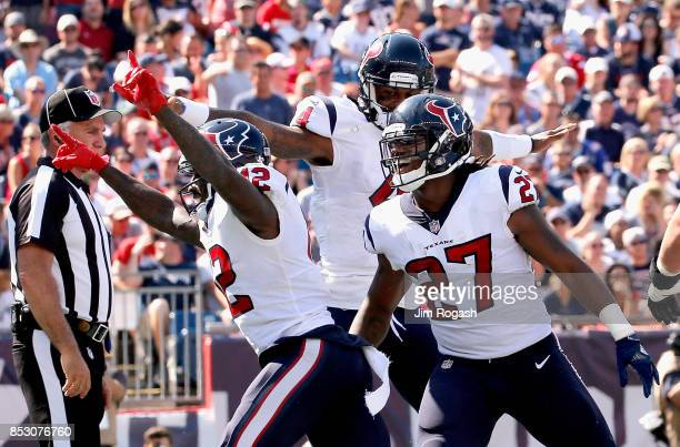 Bruce Ellington of the Houston Texans reacts with Deshaun Watson and D'Onta Foreman after catching a touchdown pass during the first quarter of a...