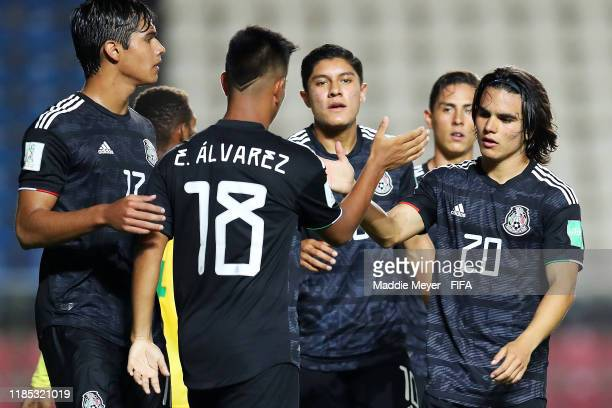 Bruce El-Mesmari of Mexico and Luis Puente congratulate Efrain Alvarez after he scored a goal during the FIFA U-17 World Cup Brazil 2019 Group F...