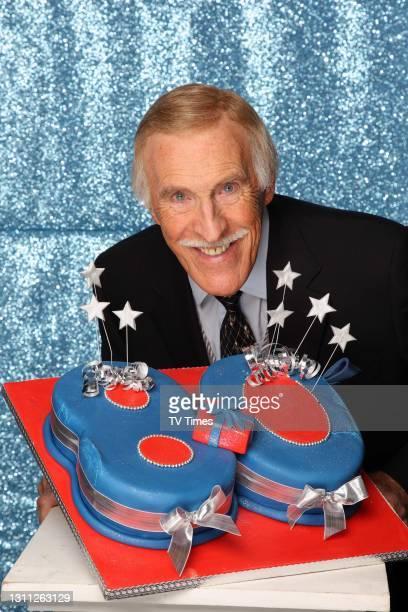 Bruce Forsyth 80th birthday with cake February 23, 2008.