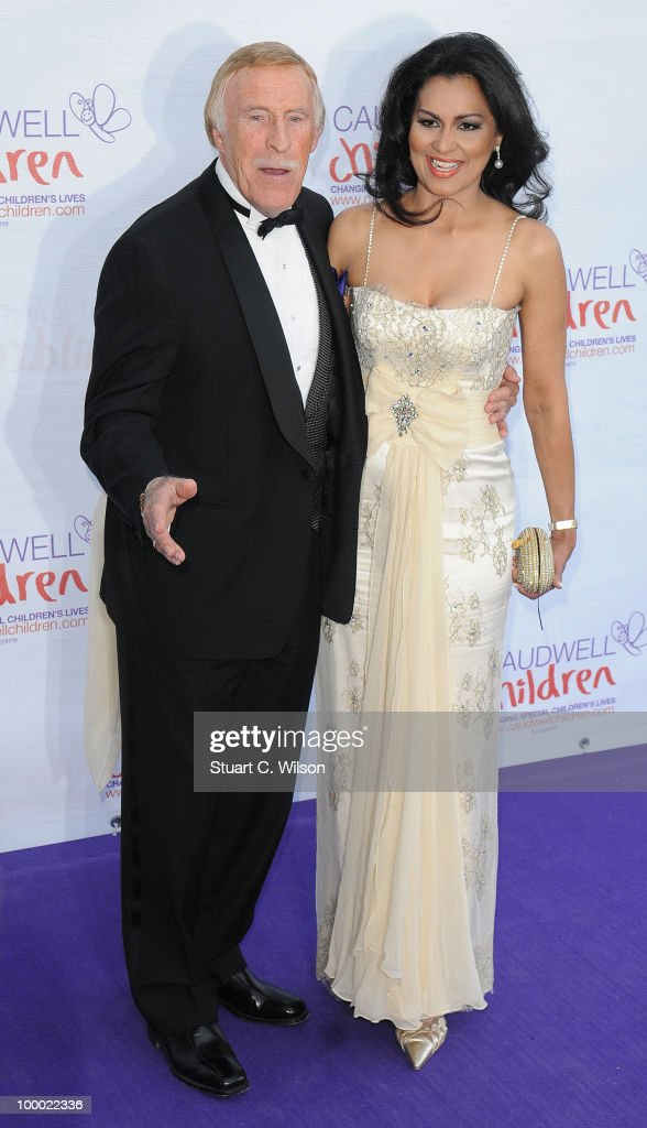Bruce Forsythe and Wilnelia Merced Forsyth attend The Caudwell Children Butterfly Ball at Battersea Evolution on May 20, 2010 in London, England.