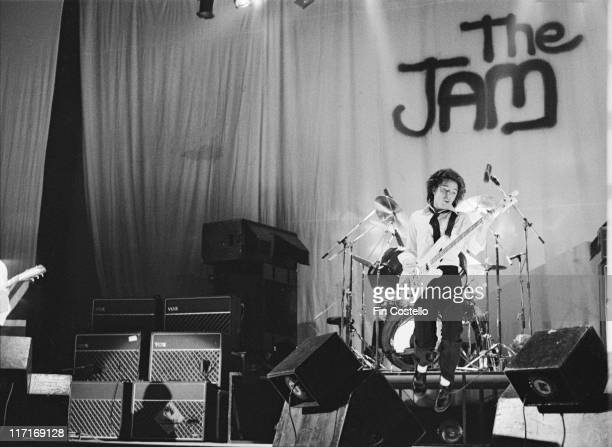 Bruce Foxton bassist with The Jam on stage during a live concert performance at the Hammersmith Odeon in London England Great Britain 18 December 1977