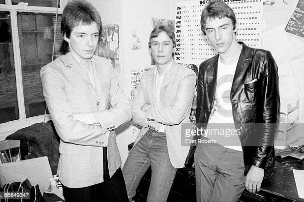 LR Bruce Foxton Rick Buckler Paul Weller posed group shot in office New York March 1978