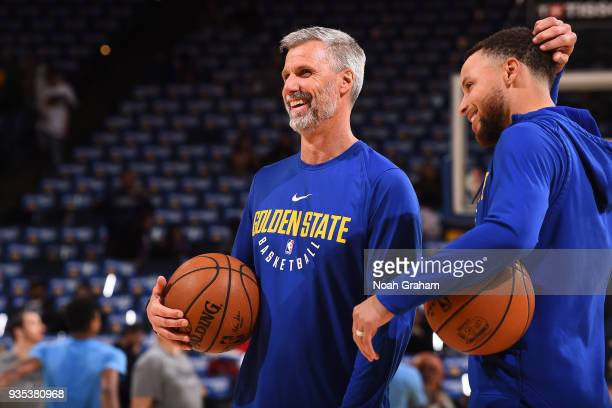 Bruce Fraser assistant coach for player development and Stephen Curry and of the Golden State Warriors look on during warms ups prior to the game...