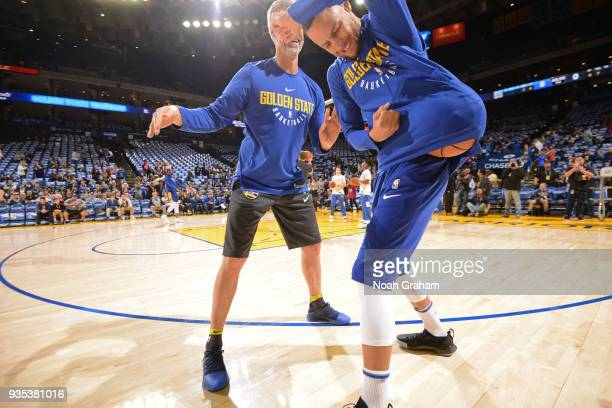 Bruce Fraser assistant coach for player development and Stephen Curry and of the Golden State Warriors warm ups prior to the game against the...