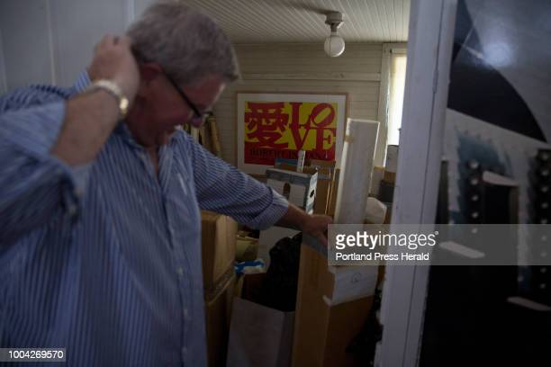 Bruce Gamage a fine art appraiser from Rockland opens up a storage closet in Robert Indiana's studio that is filled with prints Gamage has been...