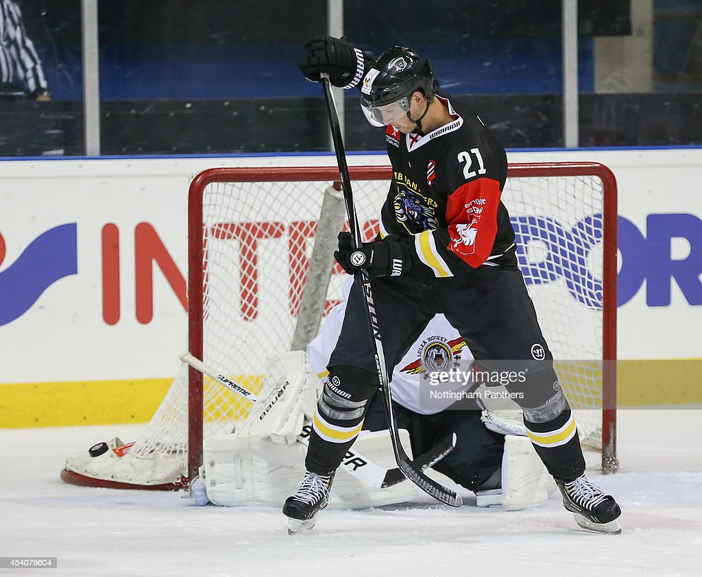 Bruce Graham #21 of Nottingham Panthers narrowly misses scoring during the Champions Hockey League group stage game between Nottingham Panthers and Lulea Hockeyat at the National Ice Centre on August 24, 2014 in Nottingham, England.