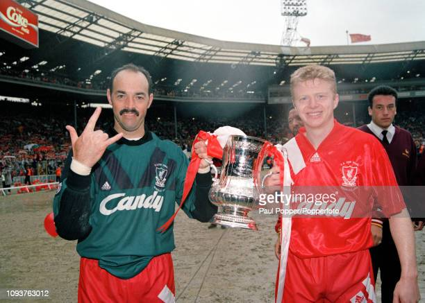 Bruce Grobbelaar and David Burrows of Liverpool celebrate with the trophy after the FA Cup Final between Liverpool and Sunderland at Wembley Stadium...