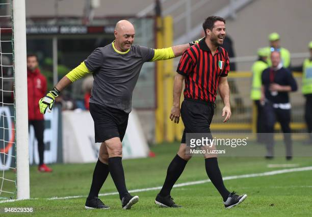 Bruce Grobbelaar and Jamie Redknapp entertain the crowd at the serie A match between AC Milan and SSC Napoli at Stadio Giuseppe Meazza on April 15...