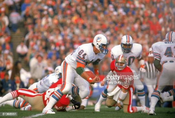Bruce Hardy of the Miami Dolphins runs with the ball during Super Bowl XIX against the San Francisco 49ers at Stanford Stadium on January 20 1985 in...