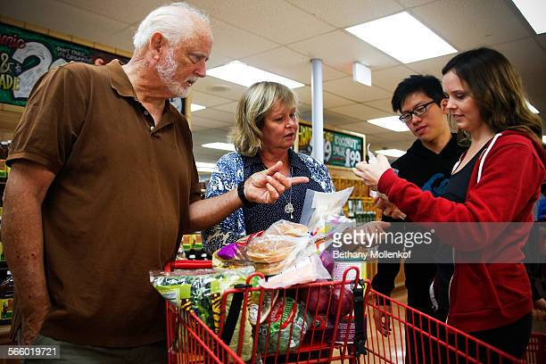 Bruce Hazelton Janet Barker Jason Kwok and Katie BarkerHazelton compare prices on a grocery shopping trip in Redondo Beach on September 11 2013 The...