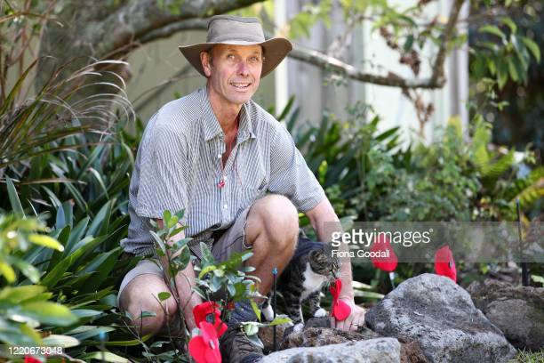 Bruce Inwood and his cat Poppy prepare an Anzac tribute in the garden in Titirangi on April 24 2020 in Auckland New Zealand New Zealanders are...