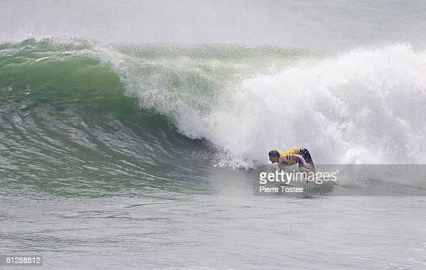 Bruce Irons of Hawaii rides a wave during round two of the Quiksilver Pro Japan event six of the Fosters ASP World Championship Tour at Hebara Beach...