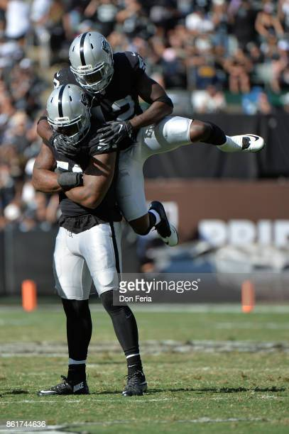 Bruce Irvin and Karl Joseph of the Oakland Raiders react to a play against the Los Angeles Chargers during their NFL game at OaklandAlameda County...