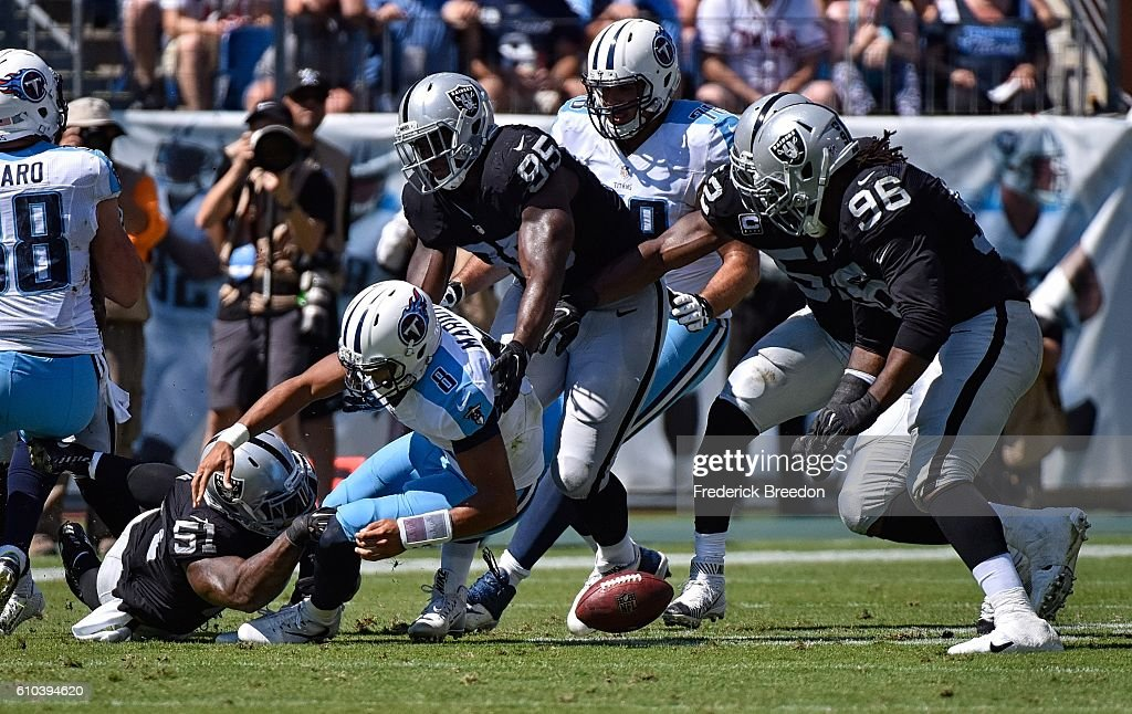 Bruce Irvin #51 of the Oakland Raiders causes quarterback Marcus Mariota #8 of the Tennessee Titans to fumble during the first half at Nissan Stadium on September 25, 2016 in Nashville, Tennessee.