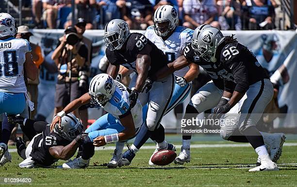 Bruce Irvin of the Oakland Raiders causes quarterback Marcus Mariota of the Tennessee Titans to fumble during the first half at Nissan Stadium on...