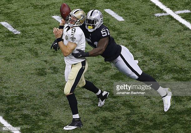 Bruce Irvin of the Oakland Raiders forces a fumble on Drew Brees of the New Orleans Saints during the first half of a game at MercedesBenz Superdome...