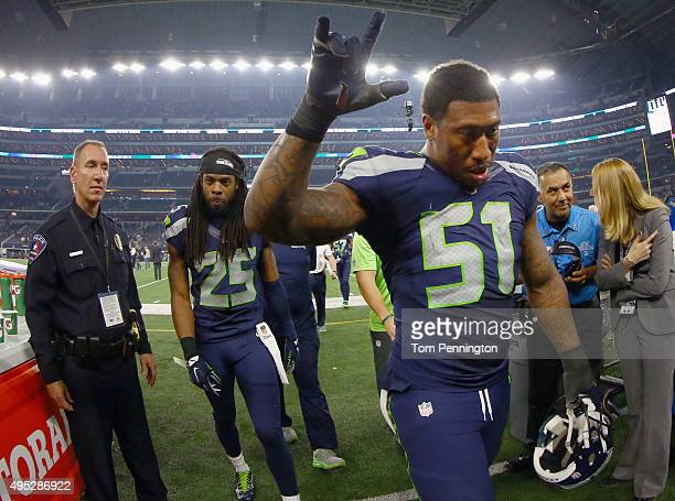 Bruce Irvin of the Seattle Seahawks and Richard Sherman of the Seattle Seahawks walk off the field after beating the Dallas Cowboys 1312 at ATT...