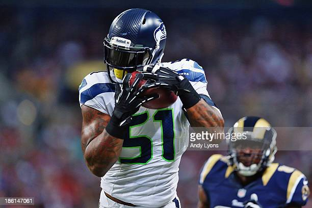 Bruce Irvin of the Seattle Seahawks intercepts Kellen Clemens the St Louis Rams during an NFL game at Edward Jones Dome on October 28 2013 in St...