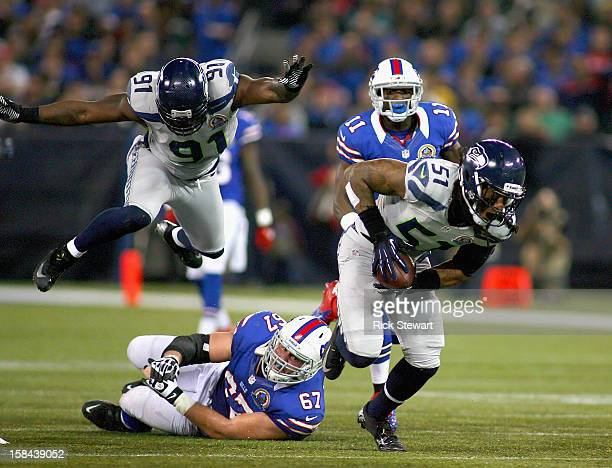 Bruce Irvin of the Seattle Seahawks picks up a fumble against the Buffalo Bills at Rogers Centre on December 16 2012 in Toronto Ontario Canada...