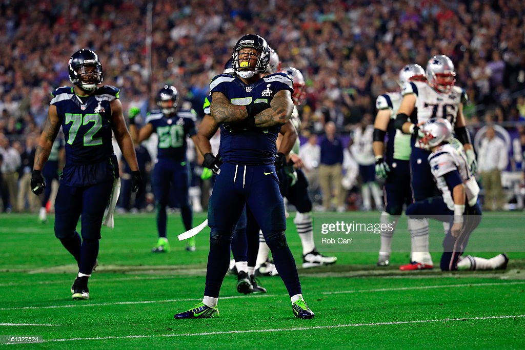 Bruce Irvin #51 of the Seattle Seahawks reacts after a sack in the fourth quarter against the New England Patriots during Super Bowl XLIX at University of Phoenix Stadium on February 1, 2015 in Glendale, Arizona.