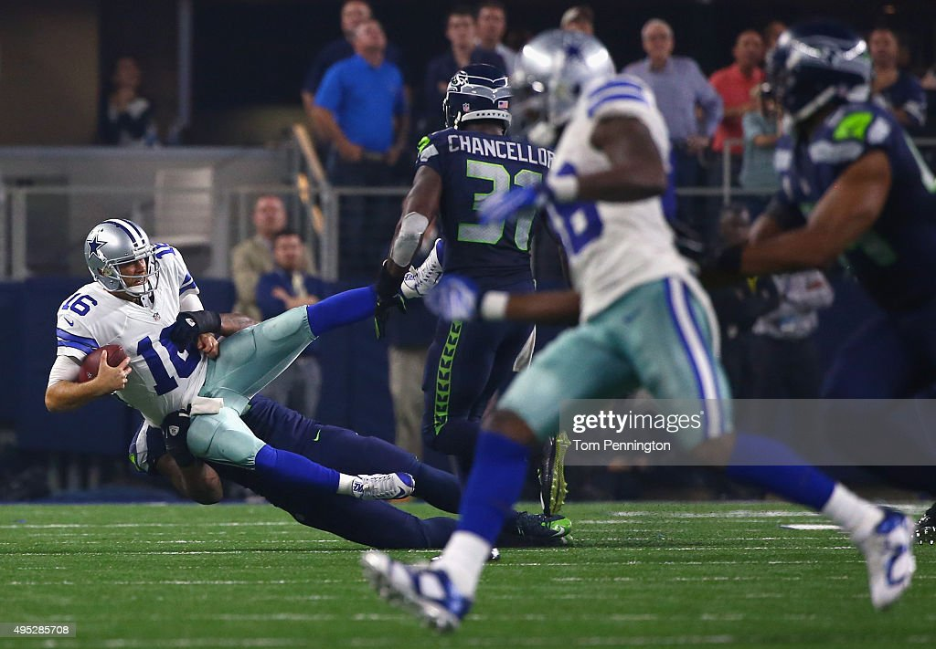 Bruce Irvin #51 of the Seattle Seahawks sacks Matt Cassel #16 of the Dallas Cowboys in the final seconds of the fourth quarter at AT&T Stadium on November 1, 2015 in Arlington, Texas.