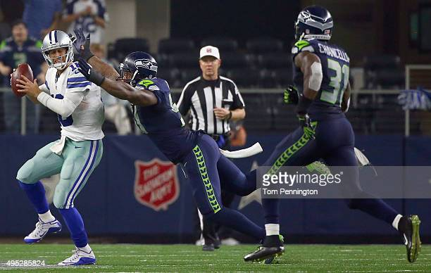Bruce Irvin of the Seattle Seahawks sacks Matt Cassel of the Dallas Cowboys in the final seconds of the fourth quarter at ATT Stadium on November 1...
