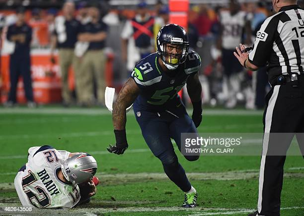 Bruce Irwin of the Seattle Seahawks reacts after sacking quarterback Tom Brady of the New England Patriots during Super Bowl XLIX February 1 2015 at...