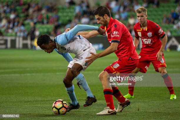 Bruce Kamau of Melbourne City controls the ball in front of Iacopo La Rocca of Adelaide United and Riley McGree of Adelaide United during the round...