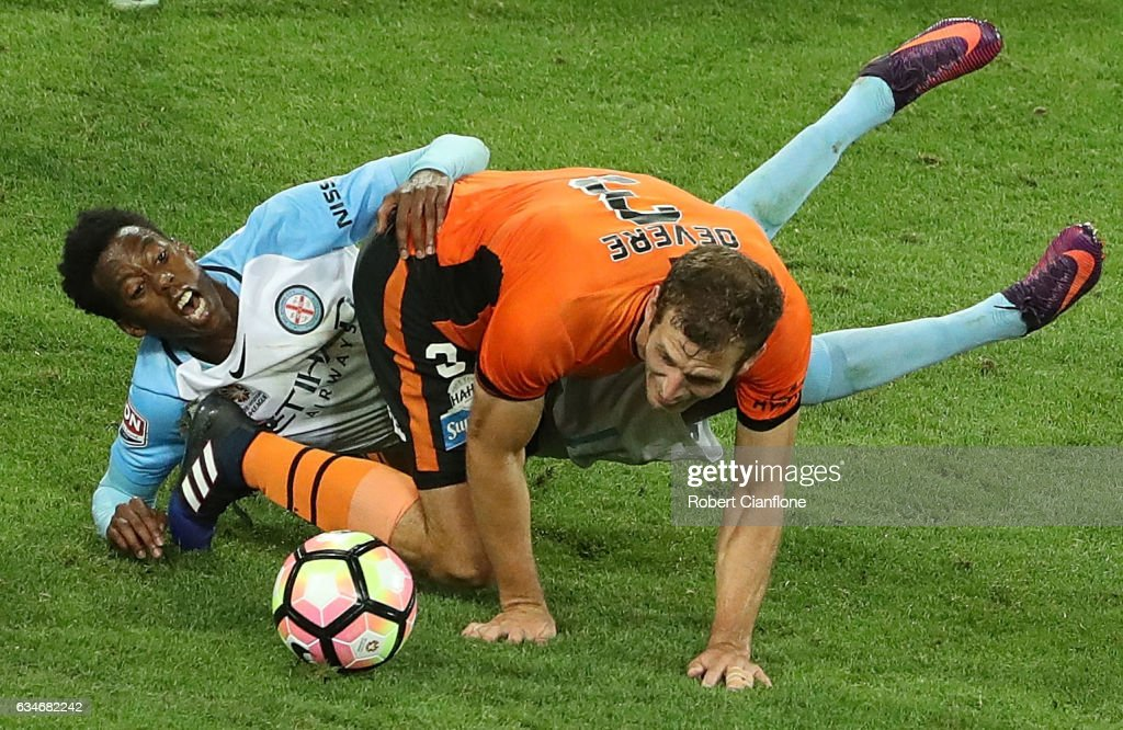 Bruce Kamau of Melbourne City is challenged by Luke Devere of the Roar during the round 19 A-League match between Melbourne City FC and the Brisbane Roar at AAMI Park on February 11, 2017 in Melbourne, Australia.