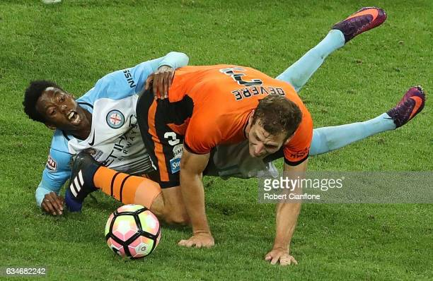 Bruce Kamau of Melbourne City is challenged by Luke Devere of the Roar during the round 19 ALeague match between Melbourne City FC and the Brisbane...