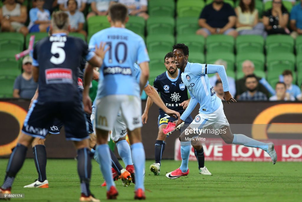 Bruce Kamau of Melbourne City tries to play the ball while holding his shoe during the round 20 A-League match between Melbourne City and Sydney FC at AAMI Park on February 10, 2018 in Melbourne, Australia.