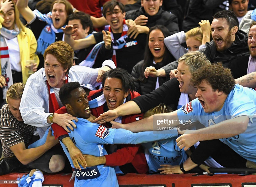 Bruce Kamau of the City celebrates scoring a goal by hugging fans during the round two A-League match between Melbourne Victory and Melbourne City FC at Etihad Stadium on October 14, 2017 in Melbourne, Australia.