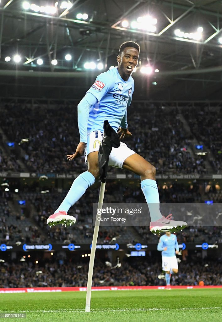 Bruce Kamau of the City celebrates scoring a goal by kicking over the corner flag during the round two A-League match between Melbourne Victory and Melbourne City FC at Etihad Stadium on October 14, 2017 in Melbourne, Australia.