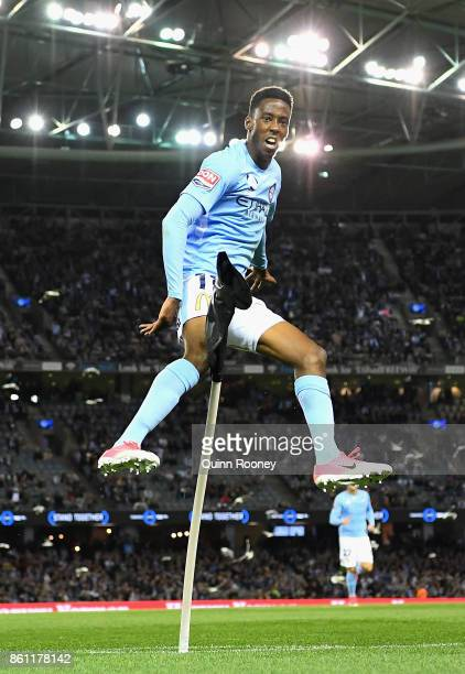 Bruce Kamau of the City celebrates scoring a goal by kicking over the corner flag during the round two ALeague match between Melbourne Victory and...