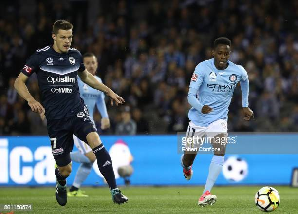 Bruce Kamau of the City is chased by James Donachie of the Victory during the round two ALeague match between Melbourne Victory and Melbourne City FC...