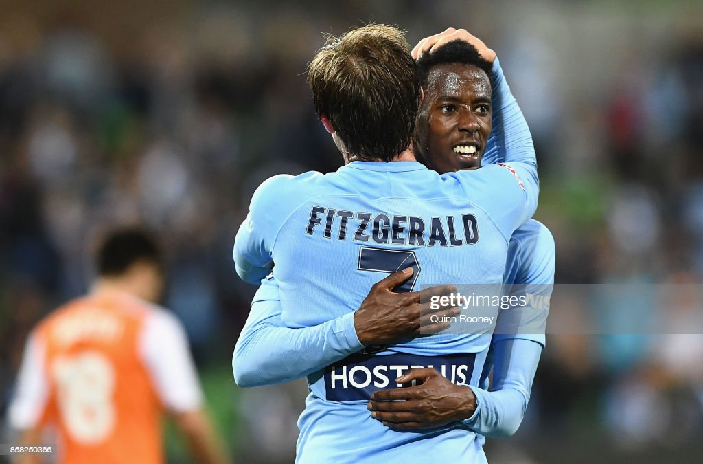 Bruce Kamau of the City is congratulated by Nick Fitzgerald after scoring a goal during the round one A-League match between Melbourne City FC and the Brisbane Roar at AAMI Park on October 6, 2017 in Melbourne, Australia.