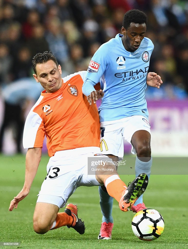 Bruce Kamau of the City is tackled by Jade North of the Roar during the round one A-League match between Melbourne City FC and the Brisbane Roar at AAMI Park on October 6, 2017 in Melbourne, Australia.